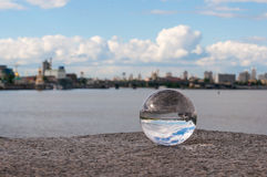Glass transparent ball on city background and Royalty Free Stock Images