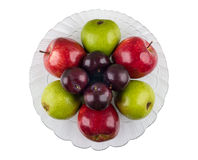 Glass transparent dish with apples, pears and plums on white Stock Photos