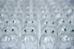 Glass transparent empty bottles assembly line Stock Photo