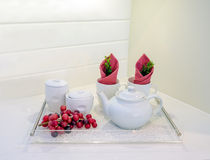 Glass tray with white teapot, cups and red grapes Royalty Free Stock Photos