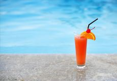 Glass of tropical cocktail on poolside. Close up Royalty Free Stock Image