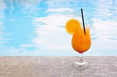 Glass of tropical cocktail on poolside. Close up Royalty Free Stock Photography