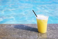Glass of tropical cocktail on poolside. Close up Stock Images