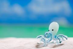Glass tropical sea  octopus on white  beach sand Stock Photo