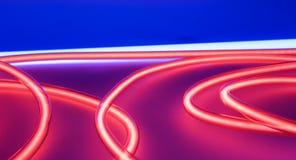 Glass tube vibrant red neon lighting lights Royalty Free Stock Image