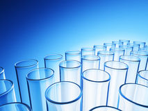 Glass Tubes. Empty glass tubes on blue background Royalty Free Stock Photography