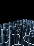 Glass Tubes. Many of glass tubes on black background Stock Photos