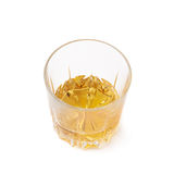 Glass tumbler filled with whiskey isolated Stock Photos