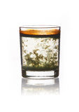Glass with turbid water stands on the spot Stock Images