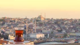 Glass of Turkish tea against the background of the center of Istanbul and Bosporus Royalty Free Stock Photography