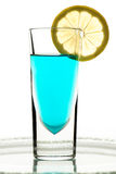 Glass with turquoise drink and lemon Royalty Free Stock Image