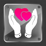 Glass two pink hearts icon in careful hands. On a metallic background Royalty Free Stock Image