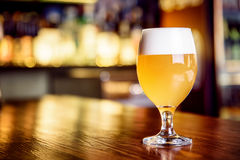 A glass of unfiltered beer on counter Stock Images
