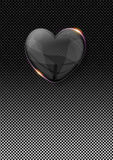 Glass valentine heart over dark metal background Royalty Free Stock Photography