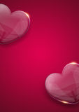 Glass valentine heart over pink background Stock Images