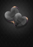 Glass valentine hearts over dark metal background Stock Photos