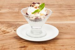 Dessert cup with ice cream and red berries. Glass with vanilla ice cream and red berries Stock Images