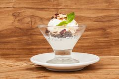 Dessert cup with ice cream and red berries. Glass with vanilla ice cream and red berries Stock Photo