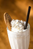 Glass of vanilla milkshake Royalty Free Stock Photos