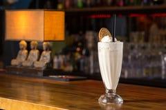 Glass of vanilla milkshake Stock Photos