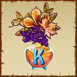 Glass vase with berries and letter K Royalty Free Stock Image