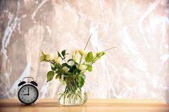 Glass vase with bouquet of beautiful flowers stock photos