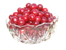 Glass vase with clear glass filled with red cherries Stock Photo