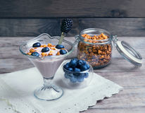 glass vase decorated with berries and granola yogurt Royalty Free Stock Photos