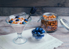 glass vase decorated with berries and granola yogurt Stock Photography