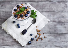 Glass vase decorated with berries and granola yogurt Royalty Free Stock Image