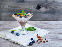 Glass vase decorated with berries and granola yogurt Royalty Free Stock Photo