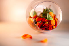 Glass vase filled with red rose petals. Aromatherapy concept. Royalty Free Stock Photos