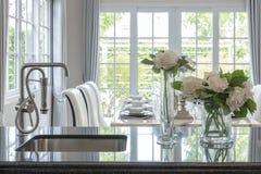 Glass vase of flower on black granite counter Stock Image