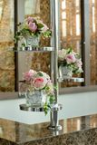 Glass vase with flowers, a beautiful ornament in a wedding Stock Photo