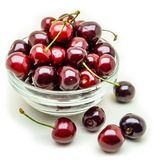 Glass vase with fresh wet cherries isolated on white background. Healthy food concept Royalty Free Stock Image