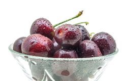 Glass vase with fresh wet cherries isolated on white background. Healthy food concept Royalty Free Stock Images