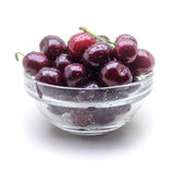 Glass vase with fresh wet cherries on white background royalty free stock images