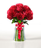 Glass vase full of big red roses, with ribbon. On white reflective surface and white background. Clipping path included Royalty Free Stock Photos