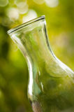 Glass vase on a green background. Shallow DOF. Stock Photos