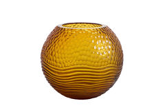 Glass vase isolated on white background. Round, fluted, orange glass vase isolated on white background Royalty Free Stock Images