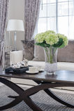 Glass vase of plant on wooden table in luxury living room Stock Photo