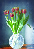 Glass vase with tulips Stock Photo