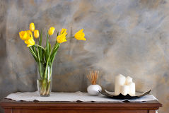 Glass vase with tulips. On the wall spatula royalty free stock photos