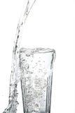 Glass vatten med tappad beeing för vatten Royaltyfria Bilder