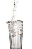Glass vatten med tappad beeing för vatten Royaltyfri Foto