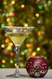 The glass of vermouth with red decoration ball. royalty free stock photography