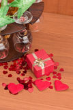 Glass of vine, red hearts and small present Stock Image
