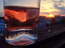 Glass of the vine is staying at the window sill stock photography