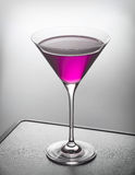 Glass of violet cocktail Stock Image