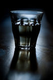 Glass of Vodka. A glass of vodka on a table Stock Photography